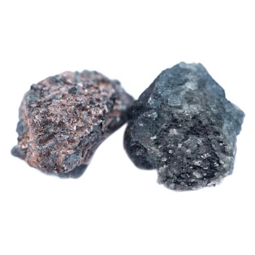 Two rough Alexandrite stones.